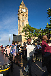London, July 8th 2016. Hundreds gather on London's Southbank before marching through the streets of London to Parliament Square, Downing Street and the BBC, in a Black Lives Matter protest in solidarity with Americans following the shooting dead of two black men, Philando Castile in Minnesota and Alton Sterling in Louisiana by police in the US. PICTURED: The protest marches past Big Ben on the way to Parliament Square.