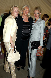 Left to right, CLARE VAN DAM, her mother PAULA BECKWITH and TAMARA BECKWITH at 'Horticouture' a charity fashion show to raise funds for Tommy's, the baby charity and The Royal Botanic Gardens, Kew held at Kew on 12th May 2005.<br />