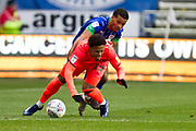 Huddersfield Town forward Josh Koroma tackled by the opponent during the EFL Sky Bet Championship match between Wigan Athletic and Huddersfield Town at the DW Stadium, Wigan, England on 14 December 2019.
