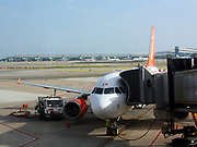 Easy Jet aeroplane boarding passengers on a runway at Barcelona Airport. Barcelona. Spain 2013
