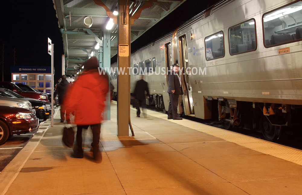 Town of Wallkill, N.Y. - Passengers walk away from their commuter train at the Metro North train station as a conductor gets ready to step back onto the train on the evening of Feb. 25, 2008.