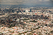 Aerial view showing the haze of pollution over the skyline and central city October 25, 2017 in Mexico City, Mexico. Mexico City is the capital of Mexico and and the most populous city North America.