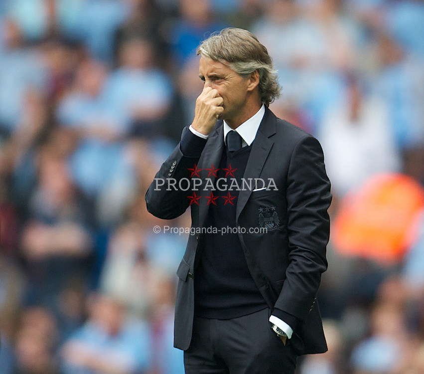 MANCHESTER, ENGLAND - Sunday, August 19, 2012: Manchester City's manager Roberto Mancini during the Premiership match against Southampton at the City of Manchester Stadium. (Pic by David Rawcliffe/Propaganda)