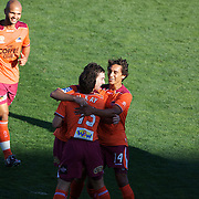 Tommy Oar celebrates with team mates after scoring Brisbane's first goal during the Central Coast Mariners V Brisbane Roar A-League match at Bluetongue Stadium, Gosford, Australia, 19 December 2009. Photo Tim Clayton