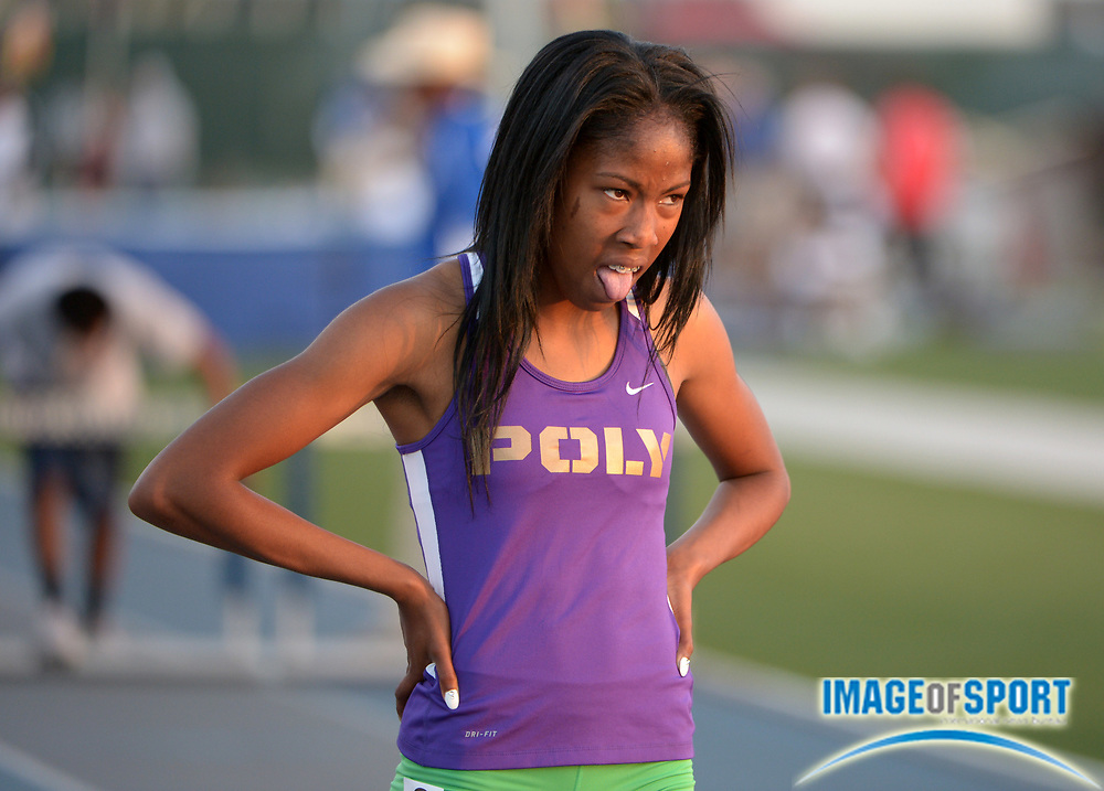 May 24, 2013; Norwalk, CA, USA; Kymber Payne of Long Beach Poly reacts after placing second in the girls 300m hurdles in the 2013 CIF Southern Section Masters Meet at Cerritos College.