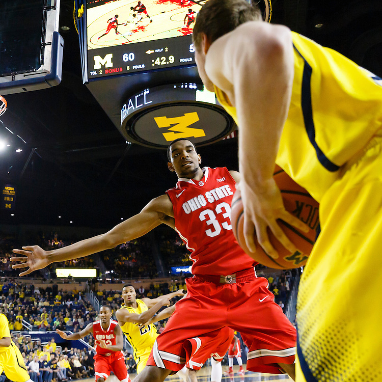 Feb 22, 2015; Ann Arbor, MI, USA; Michigan Wolverines guard Spike Albrecht (2) attempts to inbound the ball on Ohio State Buckeyes forward Keita Bates-Diop (33) in the second half at Crisler Center. Mandatory Credit: Rick Osentoski-USA TODAY Sports