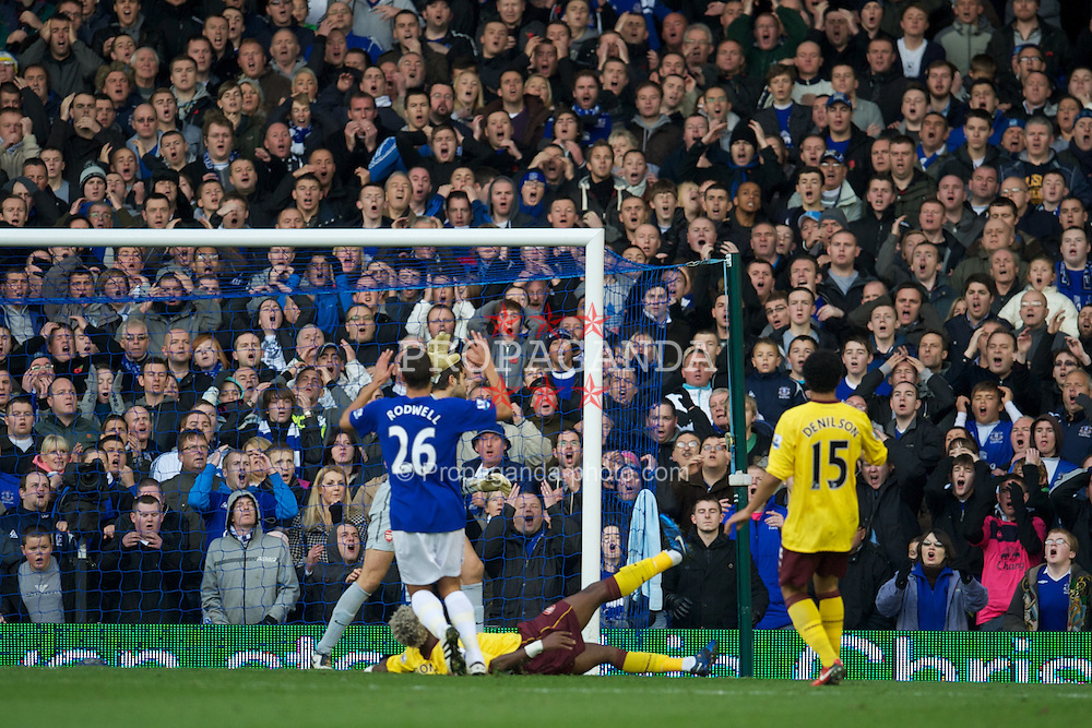 LIVERPOOL, ENGLAND - Sunday, November 14, 2010: Everton's supporters in the Gwladys Street End see Jack Rodwell's shot saved during the Premiership match against Arsenal at Goodison Park. (Photo by: David Rawcliffe/Propaganda)