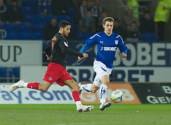 CARDIFF, WALES - Tuesday, February 1, 2011: Cardiff City's .Aaron Ramsey and Reading's Jobi McAnuff in action during the Football League Championship match at the Cardiff City Stadium. (Photo by Gareth Davies/Propaganda)