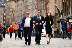 Edinburgh, Scotland, UK. 27 May, 2019. The six new Scottish MEPs are declared at the City Chambers in Edinburgh, SNP's Alyn Smith, Christian Allard and Aileen McLeod, Louis Stedman-Bruce from the Brexit Party, Sheila Ritchie of the Liberal Democrats and Baroness Nosheena Mobarik of the Conservatives. Pictured Three new SNP MEPs walk along Royal Mile l to r Christian Allard , Alyn Smith and Aileen McLeod