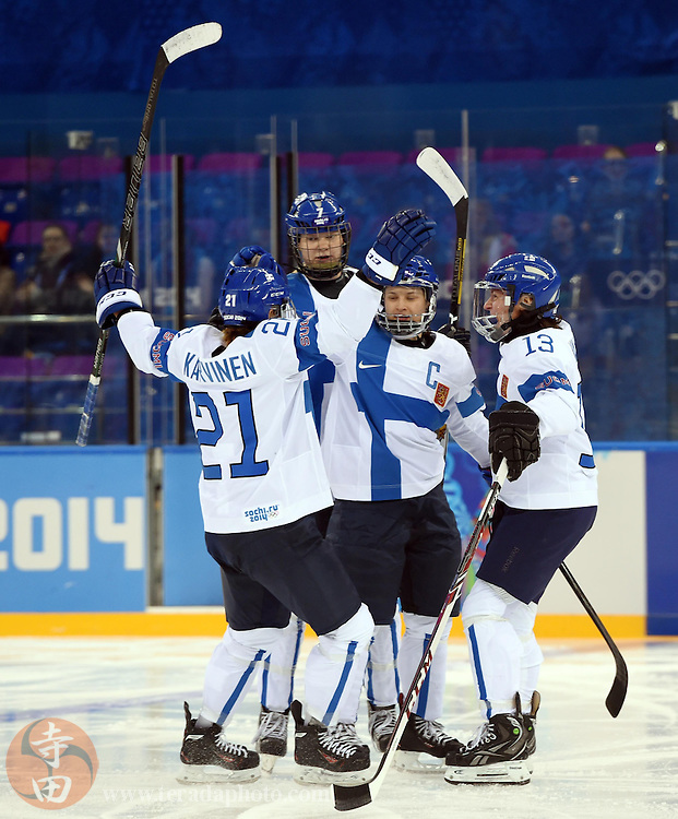 Feb 16, 2014; Sochi, RUSSIA; Finland defenseman Jenni Hiirikoski (6) is congratulated by teammates after scoring a goal against Germany in the women's ice hockey classifications round during the Sochi 2014 Olympic Winter Games at Shayba Arena.