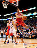 Feb. 9, 2012; Phoenix, AZ, USA; Houston Rockets guard Kevin Martin (12) makes a pass around the Phoenix Suns forward Grant Hill (33) during the first half at the US Airways Center. The Rockets defeated the Suns 96-89. Mandatory Credit: Jennifer Stewart-US PRESSWIRE.
