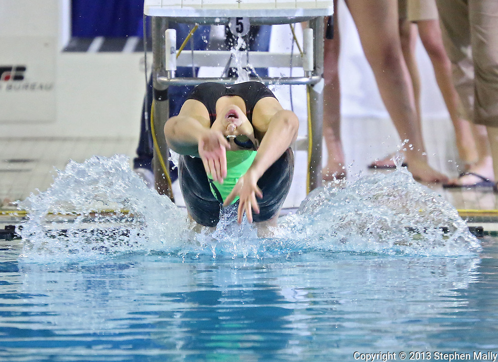Iowa City West's Lilian Zhu takes off of the blocks 100 yard backstroke event at the Girls' High School State Swimming & Diving Championships at the Marshalltown YMCA/YWCA in Marshalltown on Saturday, November 9, 2013. Zhu placed second with a time of 57.27.