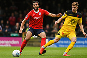 Joe Ironside of Kidderminster Harriers (9) lays off the ball with Hamza Bencherif of York City (4) at his back during the Vanarama National League match between York City and Kidderminster Harriers at Bootham Crescent, York, England on 15 September 2018.