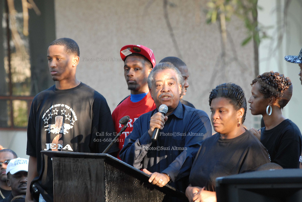 "Rev. Al Sharpton is joined by two of the Jena 6, on his left and Mrs. Bell, Mychal's mom  in front of the LaSalle parish court house Thursday Sept.20,2007. The crowd gathered chanted ""free the Jena"" and marched to the jena high school to show ther support.(photo/SuziAltman_"