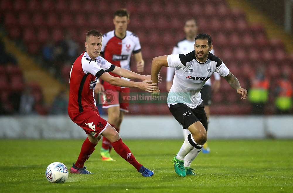 Derby County's Bradley Johnson (right) and Kidderminster Harriers' Liam Truslove battle for the ball