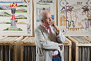 Alexander McCall Smith stands in front of finished panels stretching and in racks for the Great Tapestry of Scotland project. Photographed at the Hub in Eskbank<br /> www.scotlandstapestry.com<br /> <br /> pictures by Alex Hewitt