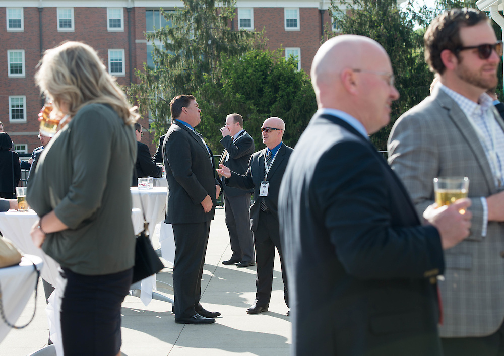 Daniel Butterly (center) speaks with Matthew Cacciato at the Charles R. Higgins Distinguished Alumnus Award Banquet outside of Nelson Commons. © Ohio University/ Photo by Kaitlin Owens