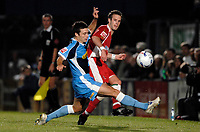 Photo: Richard Lane.<br />Wycombe Wanderers v Swindon Town. Coca Cola League 2. 26/09/2006. <br />Swindon's Andy Monkhouse passes as Wycombe's Matt Bloomfield challenges.