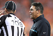 Carolina Panthers head coach Ron Rivera looks talks to officials including line judge Gary Arthur (108) during the 2016 NFL week 1 regular season football game against the Denver Broncos on Thursday, Sept. 8, 2016 in Denver. The Broncos won the game 21-20. (©Paul Anthony Spinelli)