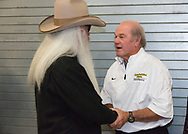 The Oak Ridge Boys, William Lee Golden greets ASU head football coach Jerry Moore backstage of benefit concert in Boone NC for the Sugar Grove Developmental Day School