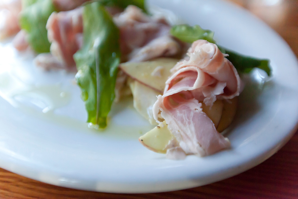 A dish of cured ham, apples and arugala is sourced from local farmers before being served at Wild Olive restaurant on Wadmalaw Island, South Carolina.