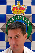 UK. Liverpool. Professional 'Streaker' Mark Roberts poses in front of a Merseyside police van at Liverpool Docks..Photo©Steve Forrest/Workers' Photos.