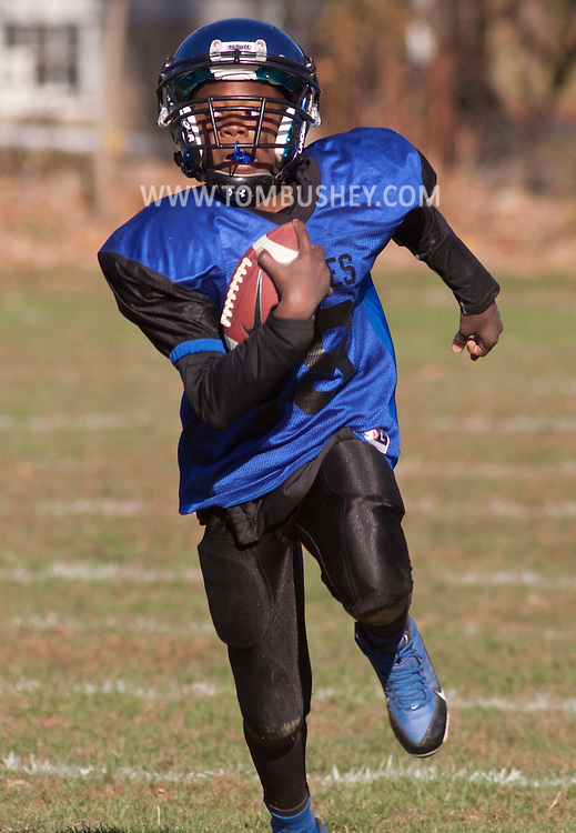 Middletown, New York - A Middletown runner carries the ball during an Orange County Youth Football League Division II semifinal playoff game at Watts Park on  Nov. 15, 2014.