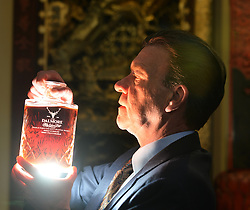 Whisky specialist Martin Green with a bottle of Dalmore whisky from 1926, estimated to reach over £20,000 GBP at the rare whisky and Asian artifacts sales at Bonham's in Edinburgh this week.<br /> <br /> © Dave Johnston/ EEm