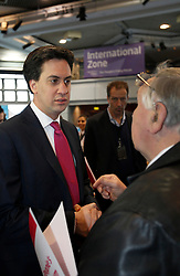 © Licensed to London News Pictures. 23/3/2013. Birmingham, UK. Labour Policy Forum at the ICC. Pictured, Labour Leader Ed Miliband discusses a point with Trevor Church. Photo credit : Dave Warren/LNP