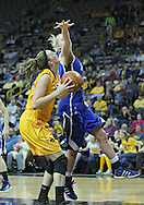 December 20, 2011: Iowa Hawkeyes center Morgan Johnson (12) eyes the basket as Drake Bulldogs forward/center Stephanie Running (44) tries to block the shot during the NCAA women's basketball game between the Drake Bulldogs and the Iowa Hawkeyes at Carver-Hawkeye Arena in Iowa City, Iowa on Tuesday, December 20, 2011. Iowa defeated Drake 71-46.