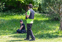 © Licensed to London News Pictures. 08/05/2020. London, UK. Environment Officers in Cannizzaro Park Wimbledon Village South West London, politely speak to members of the public about the rules on social distancing and exercise as Londoners go out to exercise during lockdown were temperatures are predicted to reach 25c. On Sunday the Prime Minister Boris Johnson will address the Nation on his plans on easing the current lockdown situation. Photo credit: Alex Lentati/LNP