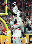 GLENDALE, AZ - JANUARY 01:  Wide receiver Michael Thomas #3 of the Ohio State Buckeyes celebrates his first quarter touchdown with offensive lineman Pat Elflein #65 of the Ohio State Buckeyes during the BattleFrog Fiesta Bowl against the Notre Dame Fighting Irish at University of Phoenix Stadium on January 1, 2016 in Glendale, Arizona.  (Photo by Jennifer Stewart/Getty Images)