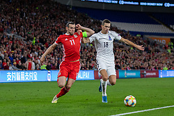 CARDIFF, WALES - Friday, September 6, 2019: Wales' captain Gareth Bale (L) and Azerbaijan's Anton Krivotsyuk during the UEFA Euro 2020 Qualifying Group E match between Wales and Azerbaijan at the Cardiff City Stadium. (Pic by Mark Hawkins/Propaganda)