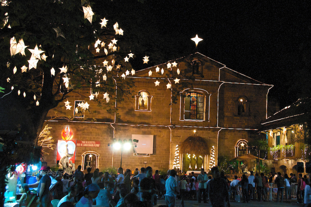 Crowds gather in the courtyard of St. Joseph's Church - Home of the Bamboo Organ - in Las Pinas, where the pre-Christmas celebration of Simbang Gabi is being held.