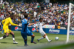 August 21, 2010; Santa Clara, CA, USA;  San Jose Earthquakes forward Chris Wondolowski (8) beats Los Angeles Galaxy goalkeeper Donovan Ricketts (1) to score a goal during the first half at Buck Shaw Stadium.
