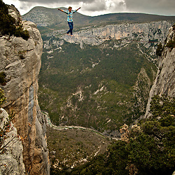"""Salewa ambassador, Mich Kemeter, soloing (no safety leash) a """"short"""" 18m highline, 200m high, rigged in the Sordidon sector of Verdon Gorges, France...2012 © Pedro Pimentel"""