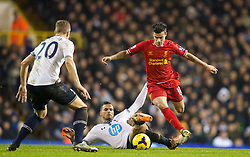 LONDON, ENGLAND - Sunday, December 15, 2013: Liverpool's Philippe Coutinho Correia in action against Tottenham Hotspur's Nacer Chadli during the Premiership match at White Hart Lane. (Pic by David Rawcliffe/Propaganda)