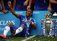 Football - 2014 / 2015 Premier League - Chelsea vs. Sunderland.   <br /> <br /> Chelsea's Didier Drogba with the Premier League trophy at Stamford Bridge.<br /> <br /> COLORSPORT/DANIEL BEARHAM