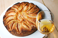 Hannukah apple cake, by .American chef Daniel Rose, of the restaurant Spring, in Paris..with a glass of calvados (apple brandy from Normandy), one of its ingredients.....Photograph by Owen Franken for the NY Times ..December 10, 2008...