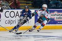 KELOWNA, CANADA - SEPTEMBER 3: Vladimir Bobylev #23 of Victoria Royals is checked by Konrad Belcourt #5 of Kelowna Rockets on September 3, 2016 at Prospera Place in Kelowna, British Columbia, Canada.  (Photo by Marissa Baecker/Shoot the Breeze)  *** Local Caption *** Konrad Belcourt; Vladimir Bobylev;