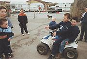 Kids on a quad bike, Winterbourne Travellers site, Bristol, UK, 1990's