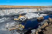 Digger loader and earth moving trucks at the Usutu Mine