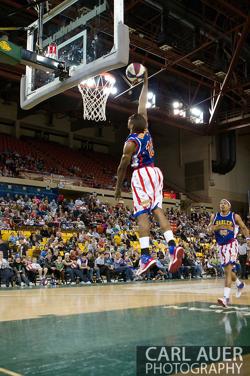 April 30th, 2010 - Anchorage, Alaska:  Harlem Globetrotters Buckets Blakes (15) attempts to show the crowd at the Sullivan Arena that even the short Trotters can dunk.