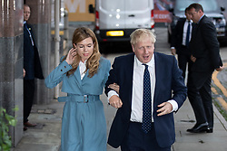 © Licensed to London News Pictures . 28/09/2019. Manchester, UK. BORIS JOHNSON arrives with CARRIE SIMMONS . The Conservative Party Conference at the Manchester Central Exhibition Centre . Photo credit: Joel Goodman/LNP