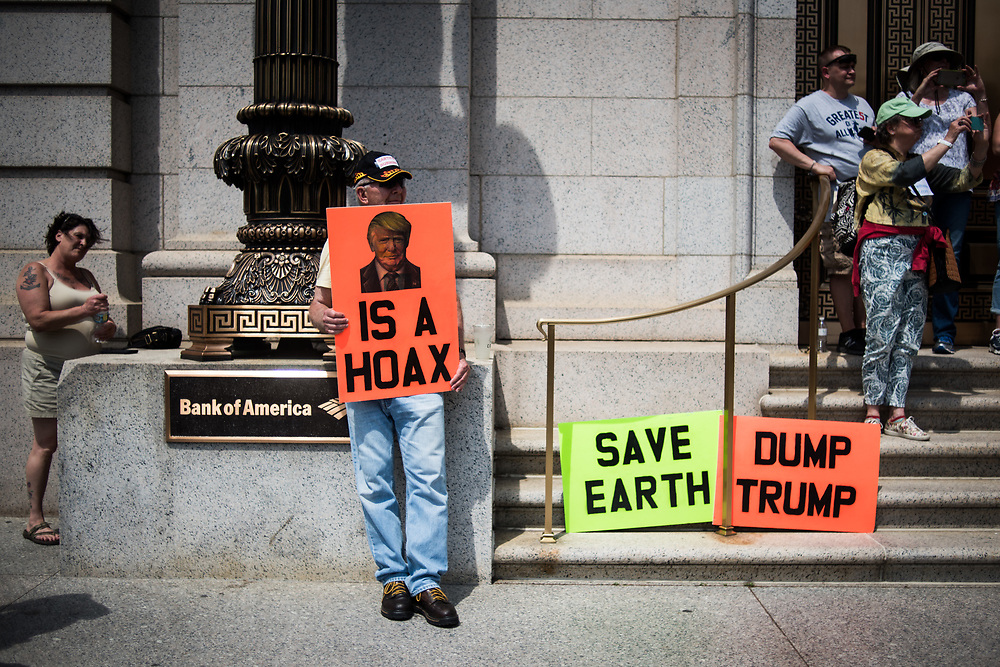A man holds a sign protesting President Donald Trump during the Climate March in Washington, D.C. on April 29, 2017. CREDIT: Mark Kauzlarich for CNN