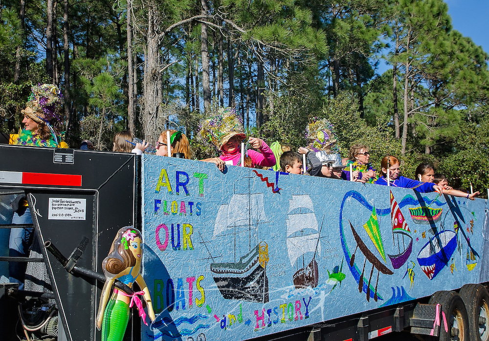 Members of the Dauphin Island Heritage and Arts Council ride on a nautical-themed float during the island's first People's Mardi Gras Parade, Feb. 4, 2017, in Dauphin Island, Alabama. French settlers held the first Mardi Gras in 1703, making Mobile's celebration the oldest Mardi Gras in the United States. The first parade of the season is traditionally held on Dauphin Island and draws thousands. (Photo by Carmen K. Sisson/Cloudybright)