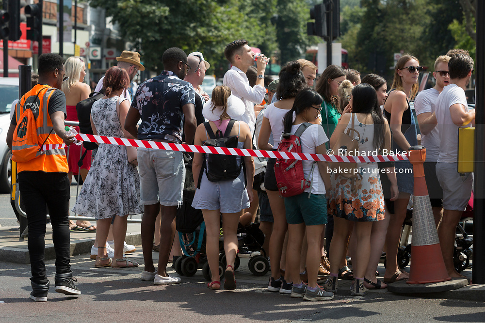 Visitors to the Lambeth Show in Herne Hill, are controlled by tape and barriers, on 21st July, in London, England