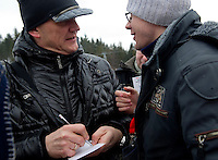(L) Polish famous actor Cezary Pazura signs souvenir cart for athete with intellectual disabilities while sport competition during VIII Polish Winter Games Special Olympics at Wisla on February 26, 2012...Poland, Wisla, February 26, 2012..Picture also available in RAW (NEF) or TIFF format on special request...For editorial use only. Any commercial or promotional use requires permission...Photo by © Adam Nurkiewicz / Mediasport