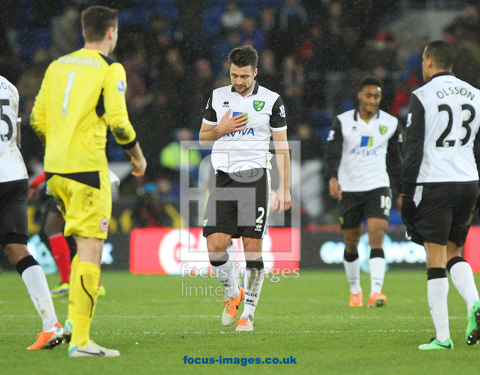 Picture by Tom Smith/Focus Images Ltd 07545141164<br /> 01/02/2014<br /> Russell Martin (centre) of Norwich City looks dejected at the end of the Barclays Premier League match at the Cardiff City Stadium, Cardiff.