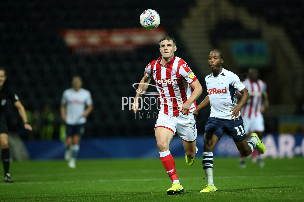 Stoke City defender Liam Lindsay (5) covers the run of Preston North End midfielder Daniel Johnson (11) during the EFL Sky Bet Championship match between Preston North End and Stoke City at Deepdale, Preston, England on 21 August 2019.